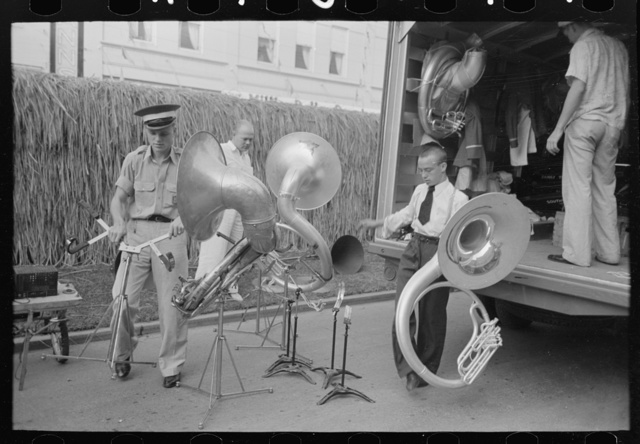 Members of Southwestern University band unloading instruments from truck, National Rice Festival, Crowley, Louisiana
