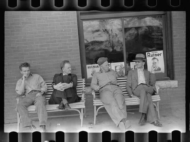 Men talking politics in front of the hotel. Osakaloosa, Kansas