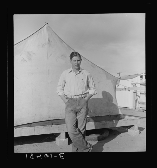 Migrant cotton picker's child who lives in a tent in the government camp instead of along the highway or in a ditch bank. Shafter Camp for migrants, California