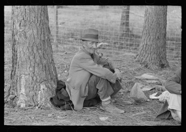 Migrant worker resting at roadside, Hancock County, Mississippi