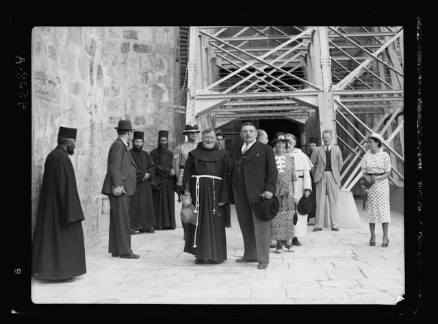 Monsieur & Madame Edouar [i.e., Edouard] Herriot visit to Jerusalem, May 11, 1938. M. Herriot and party in front of Ch. [i.e., Church] of Holy Sepulchre