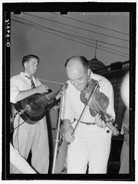 Musicians in Cajun band contest, National Rice Festival, Crowley, Louisiana. Most of the music was of the folk variety accompanied by singing