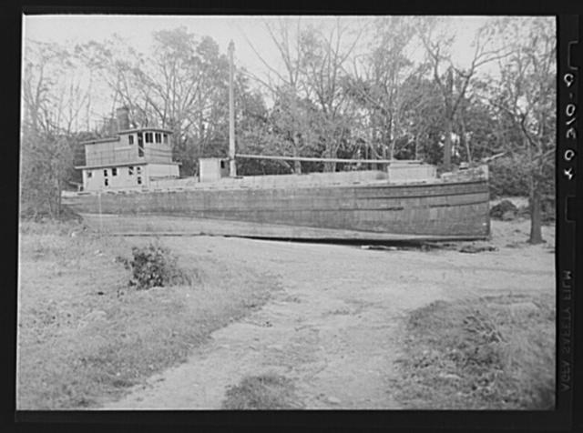 New England hurricane. Cargo boat on bay shore near Providence, Rhode Island