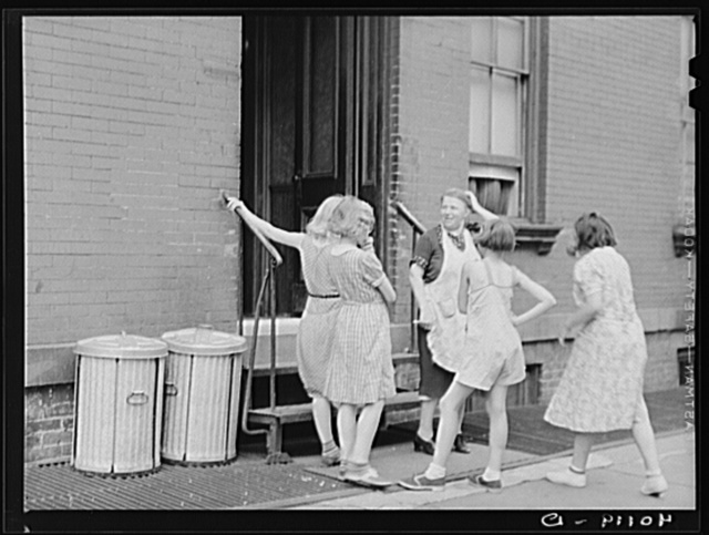 New York, New York. 1938(?) A woman and girls at the back of an apartment house on East 63rd Street