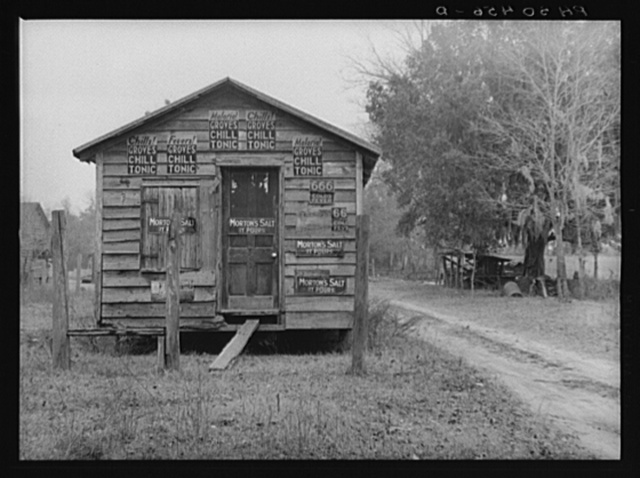 Old barn showing ads for malarial remedies near Summerville, South Carolina