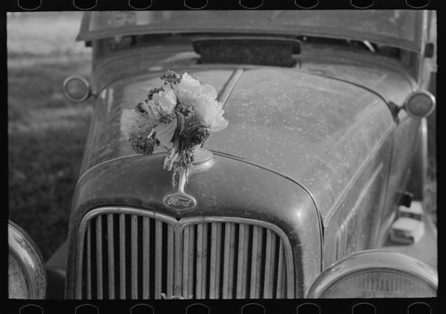 Ornament on radiator cap of automobile belonging to client, Sikeston, Missouri