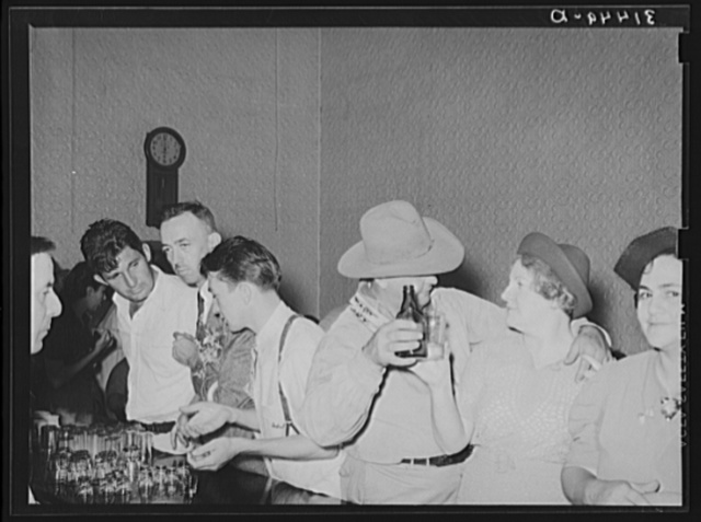 People in advanced stage of inebriation in saloon during National Rice Festival. Crowley, Louisiana