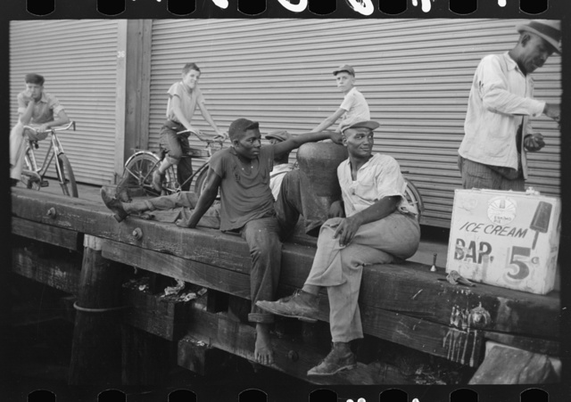 People sitting on dock, New Orleans, Louisiana