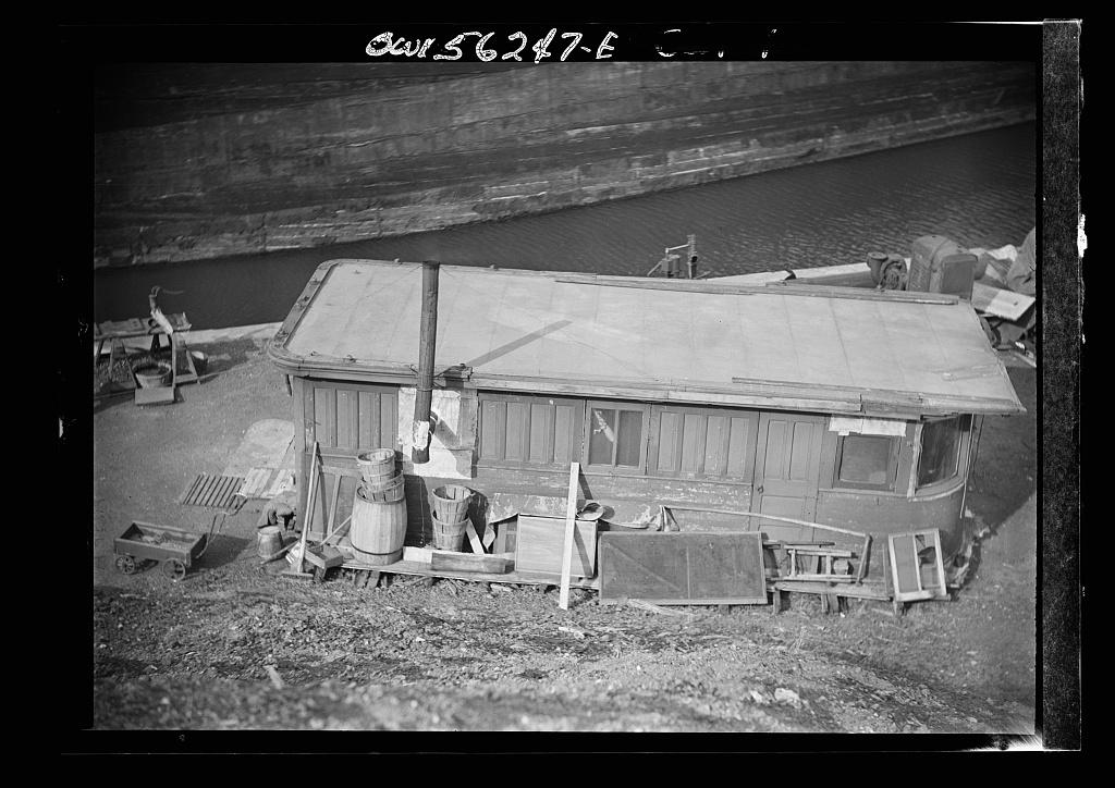 Philadelphia, Pennsylvania. Wheelhouse of an abandoned ship near the city dump used as an occupied shack