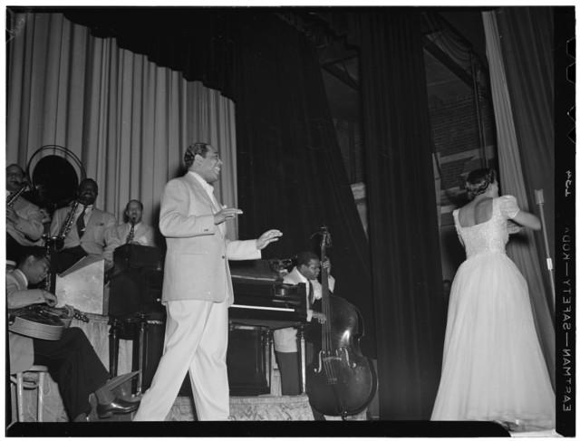 [Portrait of Duke Ellington, Barney Bigard, Ben Webster, Otto Toby Hardwick(e), Junior Raglin, and Fred Guy(?), Howard Theater(?), Washington, D.C., between 1938 and 1948]