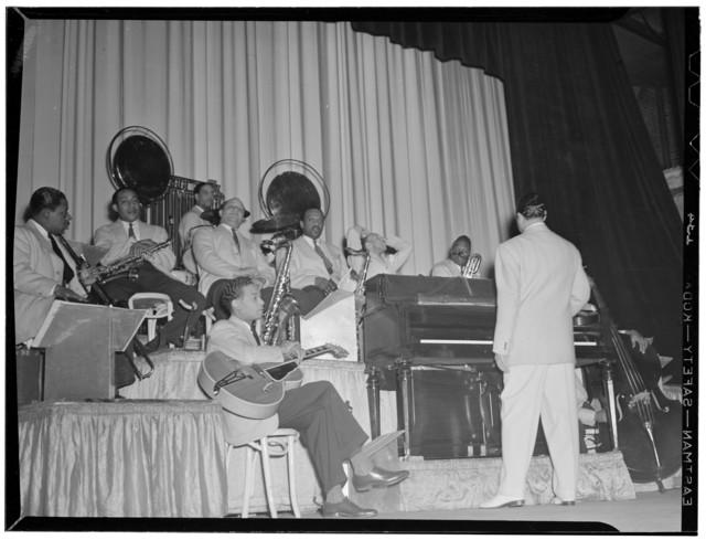 [Portrait of Duke Ellington, Junior Raglin, Juan Tizol, Barney Bigard, Ben Webster, Harry Carney, Rex William Stewart, and Sonny Greer, Howard Theater(?), Washington, D.C., between 1938 and 1948]