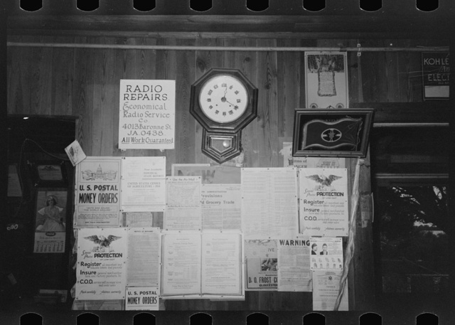 Posters and decorations in combined general store and post office, Olga, Louisinan