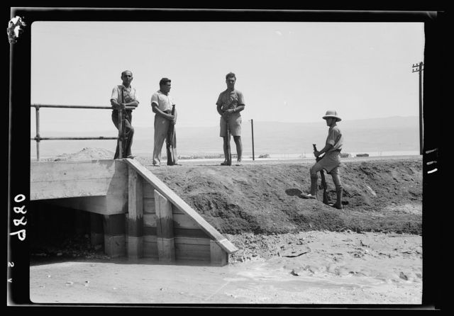 Potash lorries burned on Jericho road. Armed Jewish Potash workers guarding motor road approaching the settlement on north-end of Dead Sea