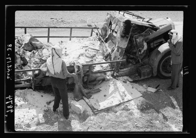 Potash lorries burned on Jericho road. Close-up of burned Potash lorry