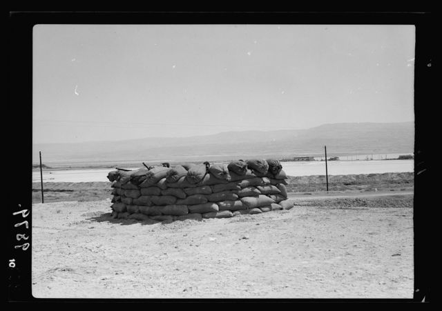 Potash lorries burned on Jericho road. Sand-bag tower manned by Jewish potash workers at north end of Dead Sea