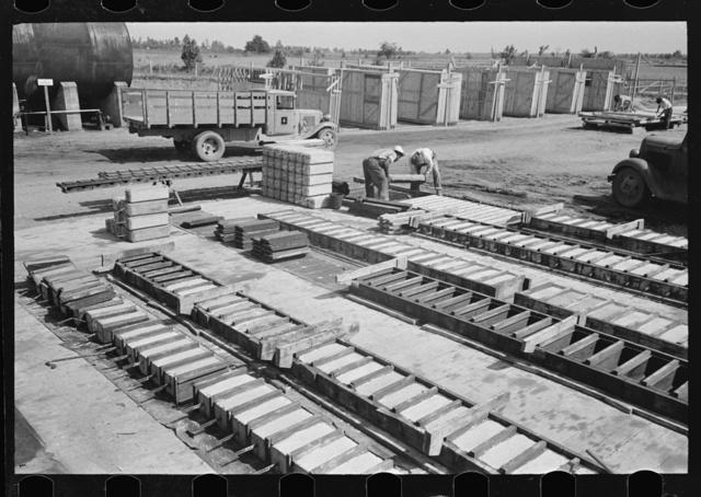 Precast concrete plant. Precasting reinforced concrete house and barn piers. Southeast Missouri Farms Project