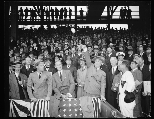 PRESIDENT THROWS OUT FIRST BALL. THE LID OF THE 1938 BASEBALL SEASON IN THE CAPITAL WAS PRIED OFF TODAY BY PRESIDENT ROOSEVELT AS HE TOSSED OUT THE FIRST BALL TO START THE GAME BETWEEN THE WASHINGTON SENATORS AND THE PHILADELPHIA ATHLETICS. IN THE PHOTOGRAPH, L TO R: AL KRESS OF SARATOGA SPRINGS, N.Y., A ROOSEVELT FAMILY FRIEND; WPA ADMINISTRATOR HARRY HOPKINS; PRESIDENT ROOSEVELT; CONNIE MACK; AND BUCKY HARRIS