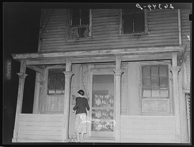 Prostitute entering house. Peoria, Illinois