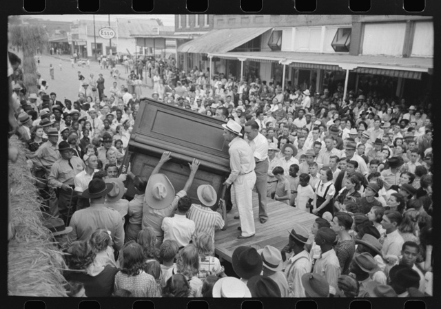 Raising piano from truck to elevated platform for Cajun band contest, National Rice Festival, Crowley, Louisiana