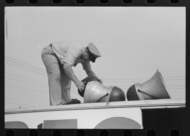Removing covers from megaphones of public address system, National Rice Festival, Crowley, Louisiana