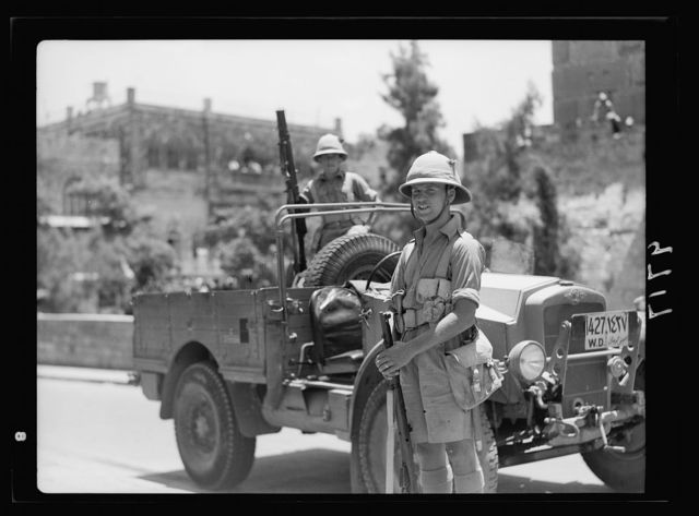 Result of terrorist acts & government measures. Military raid for arms on Jaffa Gate section, July 13, '38. Battery of armoured cars in Julian Way