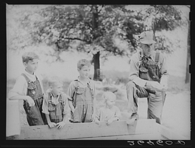 Ross Lundy and his children. Family will be resettled at Wabash Farms, Indiana