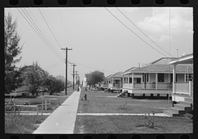 Row of cottages, Burrwood, Louisiana. This is chiefly a base for dredging operations of U.S. Engineering Corps