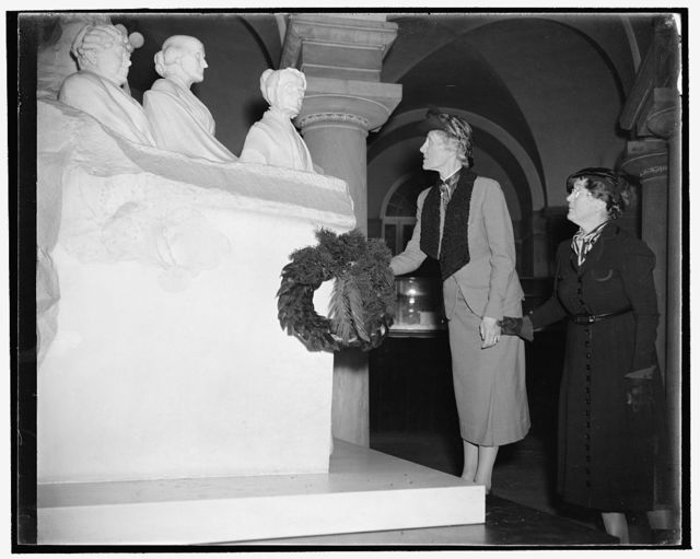 Royal Swedish feminist lays wreath at Capitol. Washington, D.C., Nov. 26, 1938. Baroness Ebba Nordenfelt, left, member of the recently organized World Women's Party, laying wreath before the Statue of the Equal Rights Pioneers located in the Capitol. The Baroness is here to make plans for Sweden's participation in the World Woman's Party meeting at its new headquarters in Geneva, Switzerland. Mrs. Annerika Fries, also of Sweden, is shown with the Baroness
