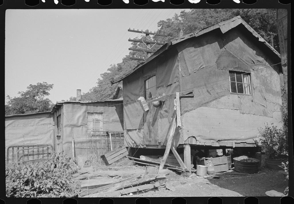 Shacks inhabited by Negroes along river on highway between Charleston and Gauley Bridge, West Virginia