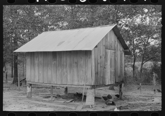 Shed on stilts belonging to farmer near Amite, Louisiana. Metal on stilts keeps out rats