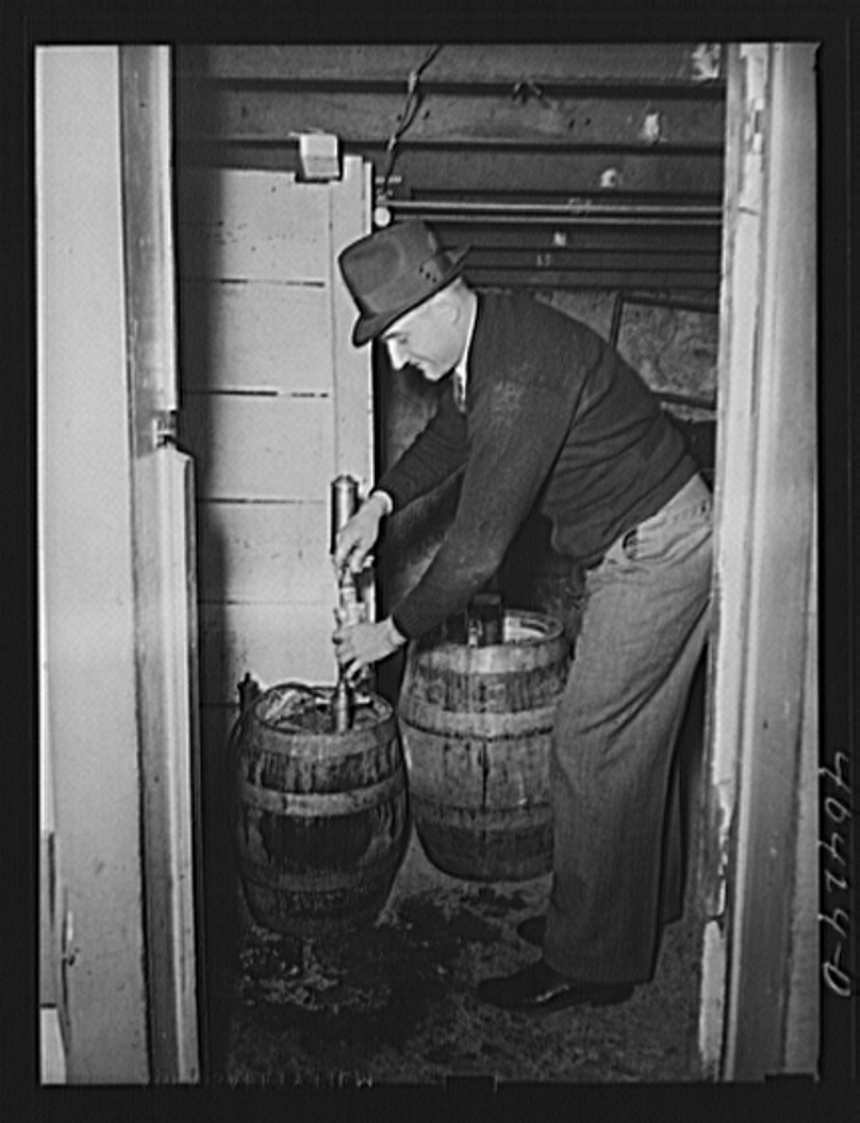"Shenandoah, Pennsylvania. Mike (""Mitzi"") Karachuta filling glasses at a beer party in Joe Gladski's cellar"