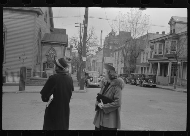 Shenandoah(?), Pennsylvania. Two women on a street corner, near a Protestant church, on Sunday morning