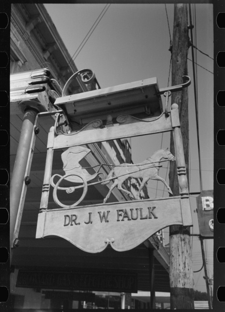 Sign in front of doctor's office, symbol of the horse and buggy doctor, Crowley, Louisiana