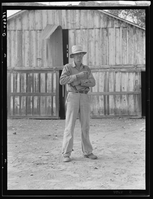 "Small cotton farmer, Kern County, California. He leases the land, and pays 1/4 of the crop for rent, also pays the water bill (irrigation). ""It's come to that there's not going to be any more small farms in California. The big fellows have got us all with a ring in our nose. You take the small farmer like me--we can't come out. There's no difference hardly between me and my pickers--only I've got a place to stay out of the rain"""