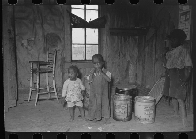 Southeast Missouri Farms. Family of sharecropper in kitchen of shack