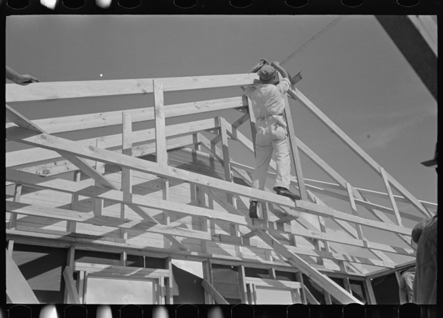 Southeast Missouri Farms Project. House erection. Shop assembled trusses are raised in place by regular erection crew of five men. No scaffolding is necessary for this operation