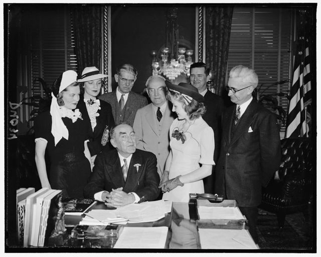 [Speaker William Bankhead at desk; with group]