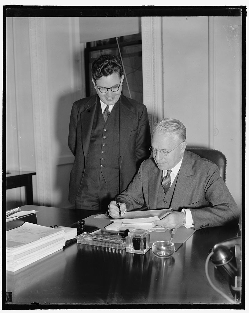 Special to the Monitor. Chief of the Cultural Relations at the State Dept. seated Dr. Ben. Cherrington, with his Asst. Dr. Richard Pattee, standing