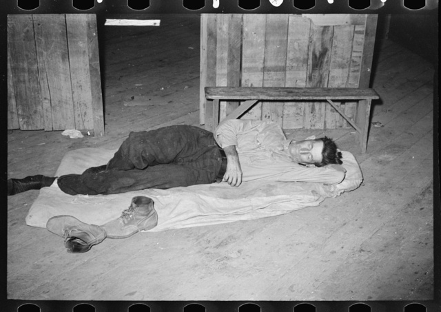 Squatters asleep on floor in warehouse, Caruthersville, Missouri