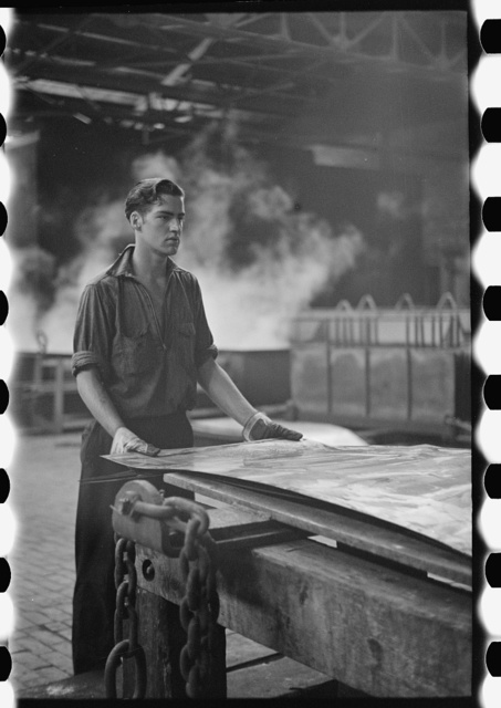Steelworker at galvanizing machine, Pittsburgh, Pennsylvania