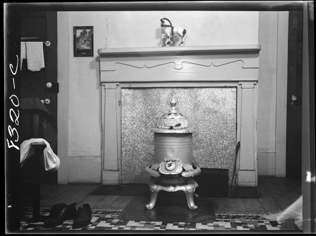 Stove in bedroom of house at Enfield, North Carolina
