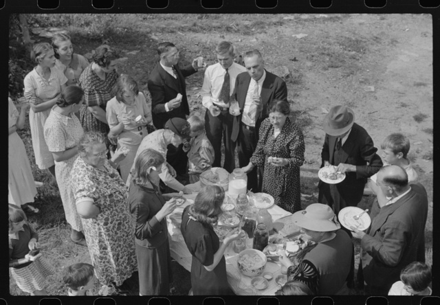 """Sunday school picnic. Much of the food brought into abandoned mining town of Jere, West Virginia by """"neighboring folk"""" from other parishes. There is a great deal of """"hard feelings"""" and many fights between Catholics and Protestants. Miners as a whole are not very religious, many not having any connections with church, though they may have religious background. Hard times has caused this to a certian extent. As one said, """"The Catholic church expected us to give when we just didn't have it"""""""