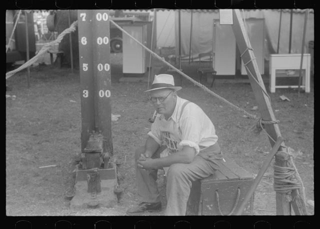 """""""Test your strength,"""" county fair, central Ohio"""