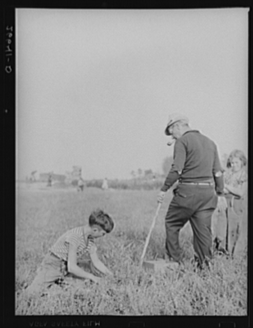 The padrone (labor contractor), who also acts as foreman in the bogs, directing a boy picking cranberries. Burlington County, New Jersey