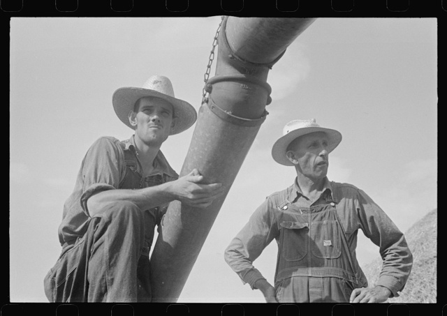 Two members of threshing crew, central Ohio (see general caption)