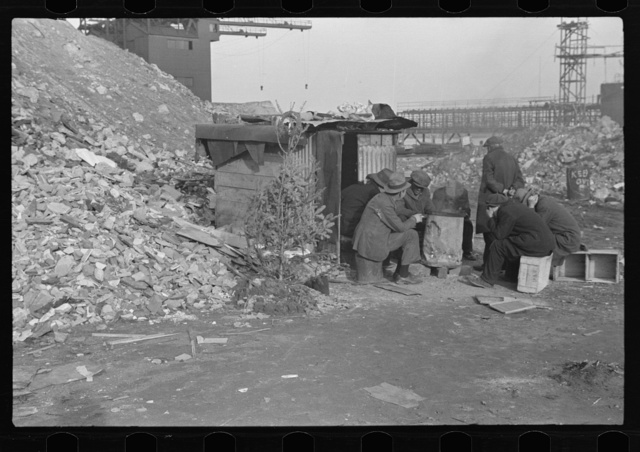 Unemployed workers in front of a shack with Christmas tree, East 12th Street, New York City