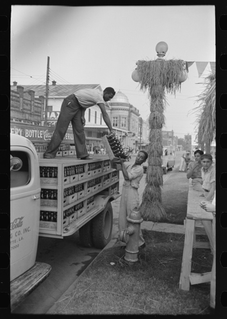 Unloading bottled drinks from truck, National Rice Festival, Crowley, Louisiana