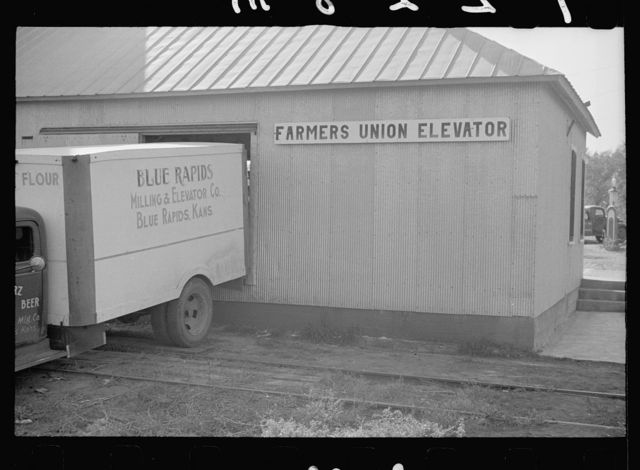 Unloading feed at Farmer's Union Coop elevator, Centralia, Kansas