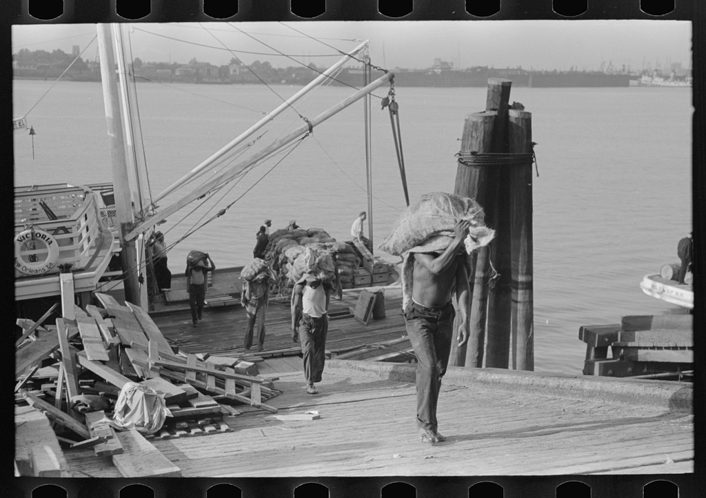Unloading oysters from packet boat arriving at New Orleans