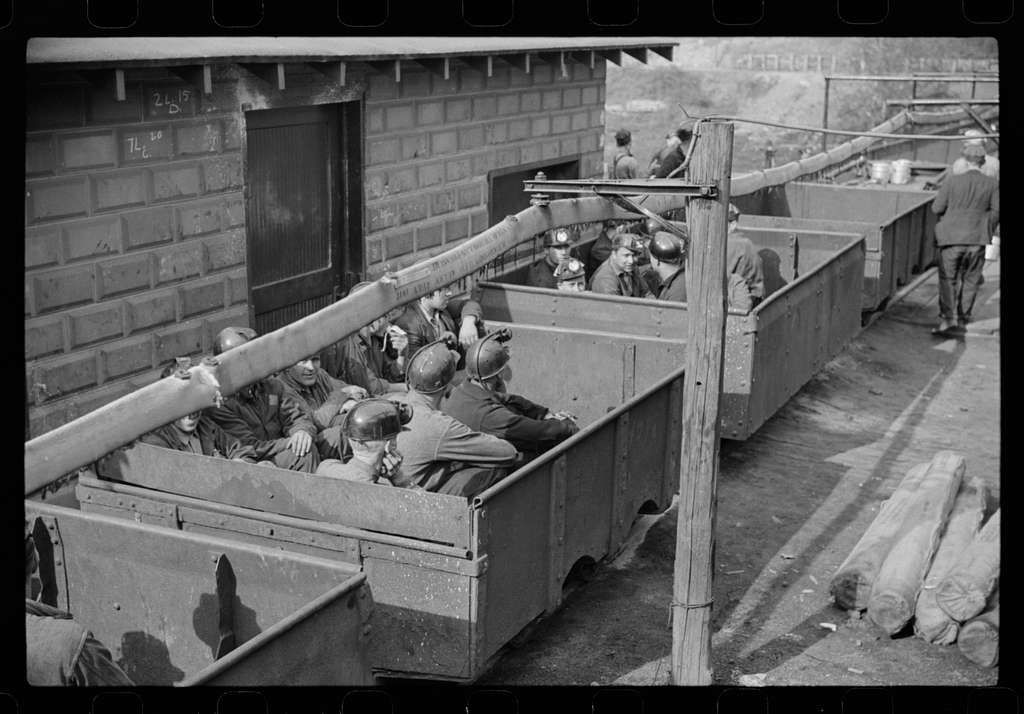 "Untitled photo, possibly related to: Coal miners in cars ready for next ""trip"" into mines, Maidsville, West Virginia"